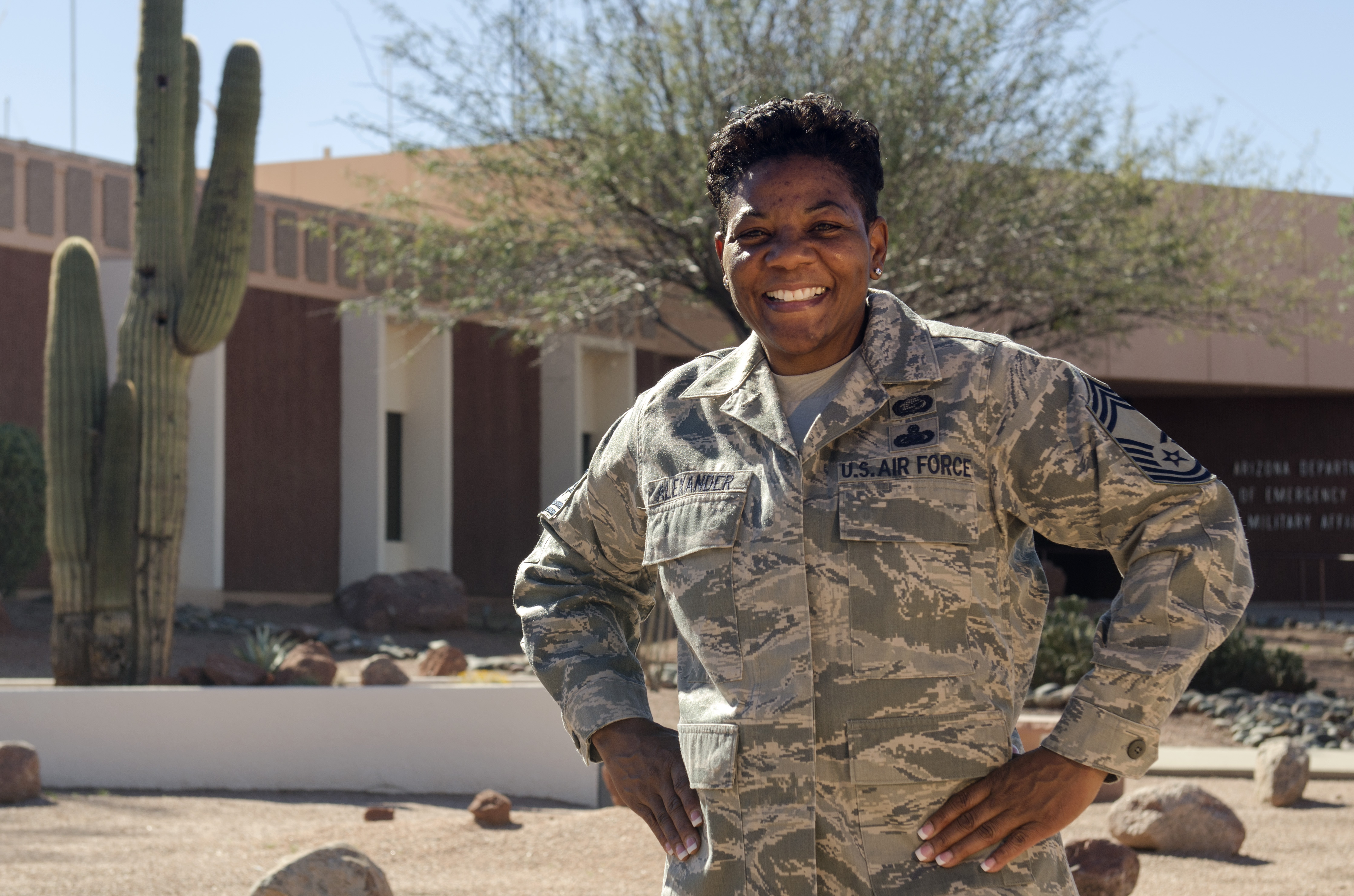 Air Force Chief Master Sgt. Barbara Alexander stands in front of Joint Force Headquarters building
