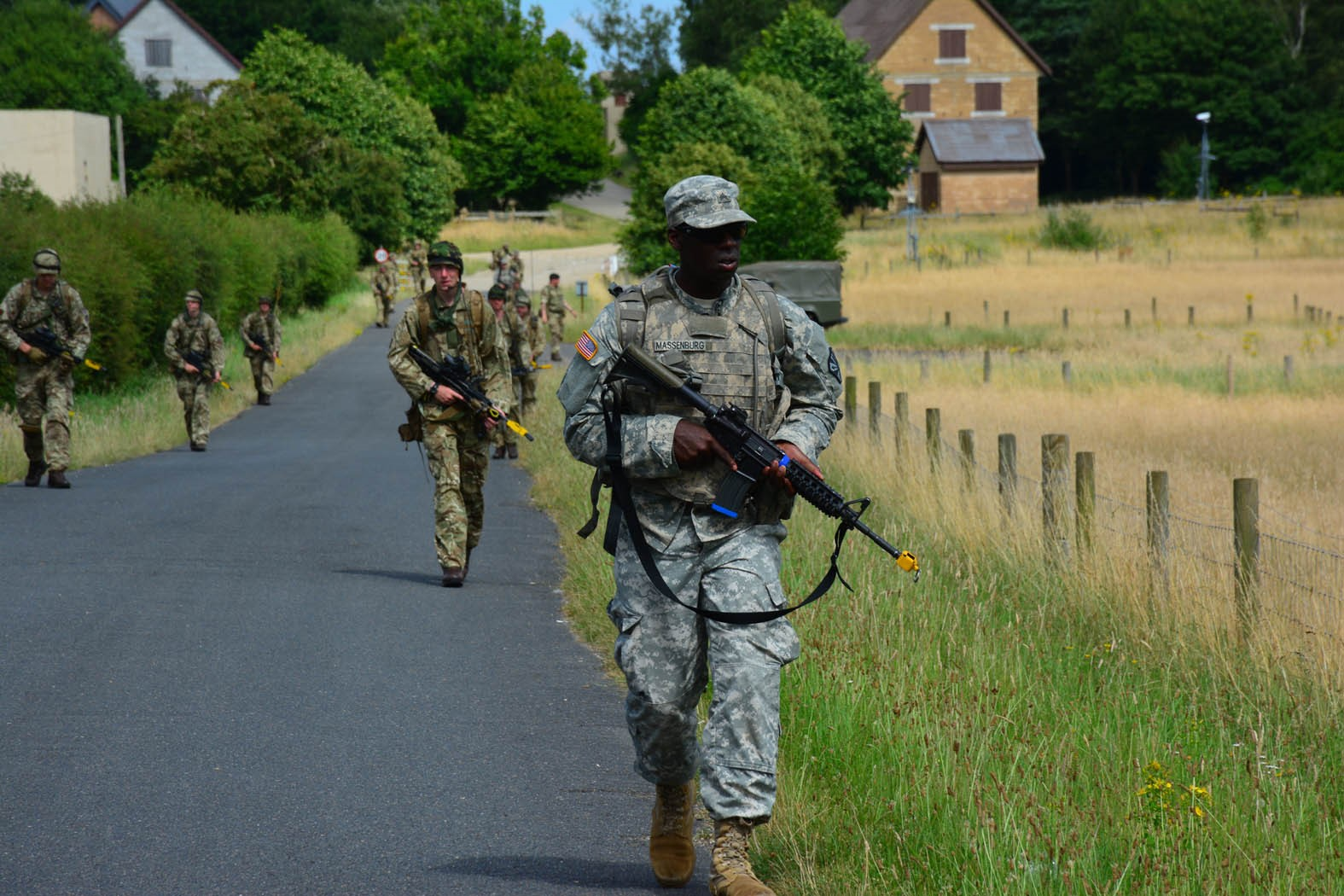 British and American Soldiers conduct joint foot patrols throughout the Stanford Training Area, United Kingdom during Steppe Eagle 16.