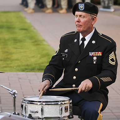 An Army Guard drummer plays during a cerremony