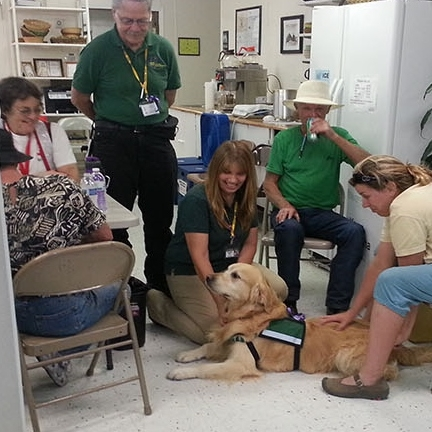 HOPE dog provides some emotional relief to workers in the Yarnell Hill IASC, July 2003. Photo by: DEMA staff