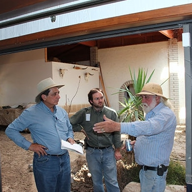 The SBA, Maricopa County and DEMA representatives meet with homeowners after a monsoon flood near New River, August 2014. Photo by: DEMA staff