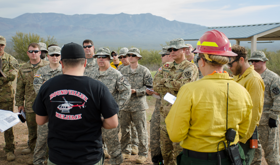 Arizona National Guard, U.S. Forest Service, and the National Park Service discuss wildfire exercise.