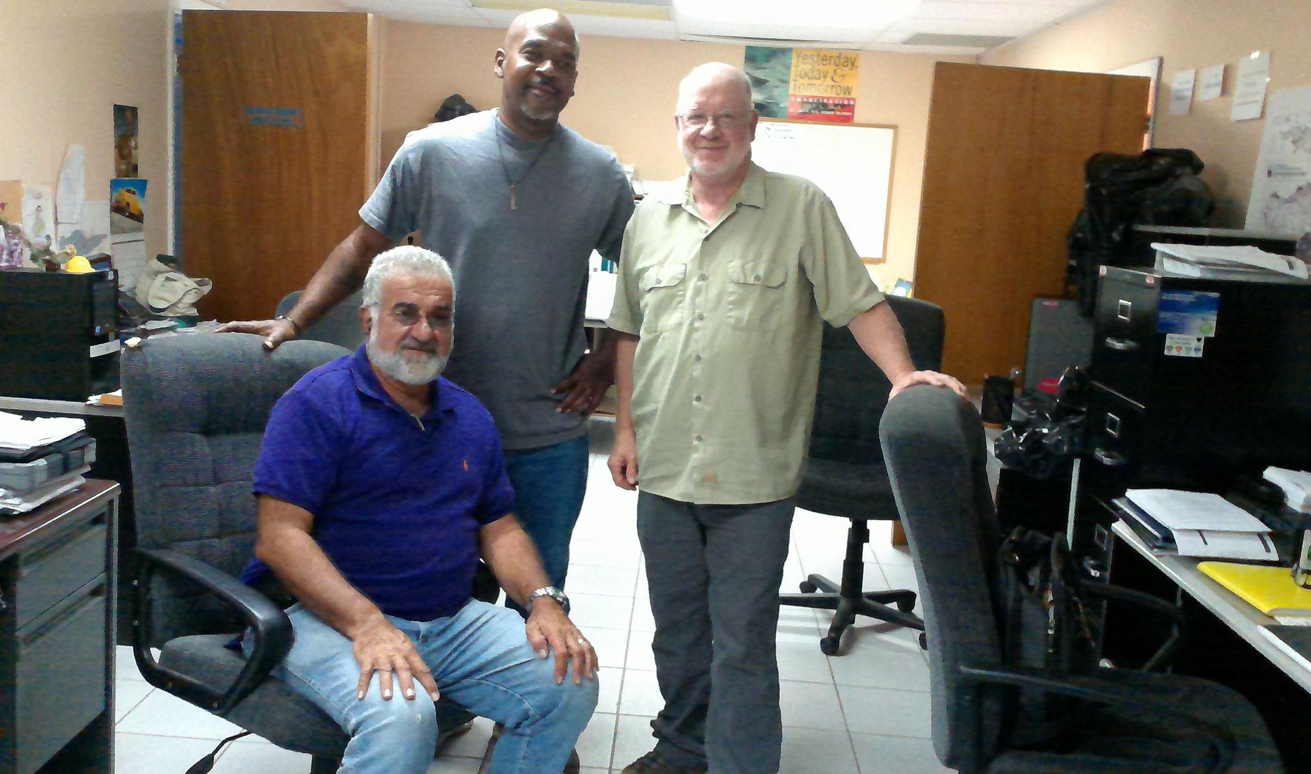 Building inspectors Alexis Doward (top left), John Flumerfelt (top right) and Leonard Ferrante (seated)
