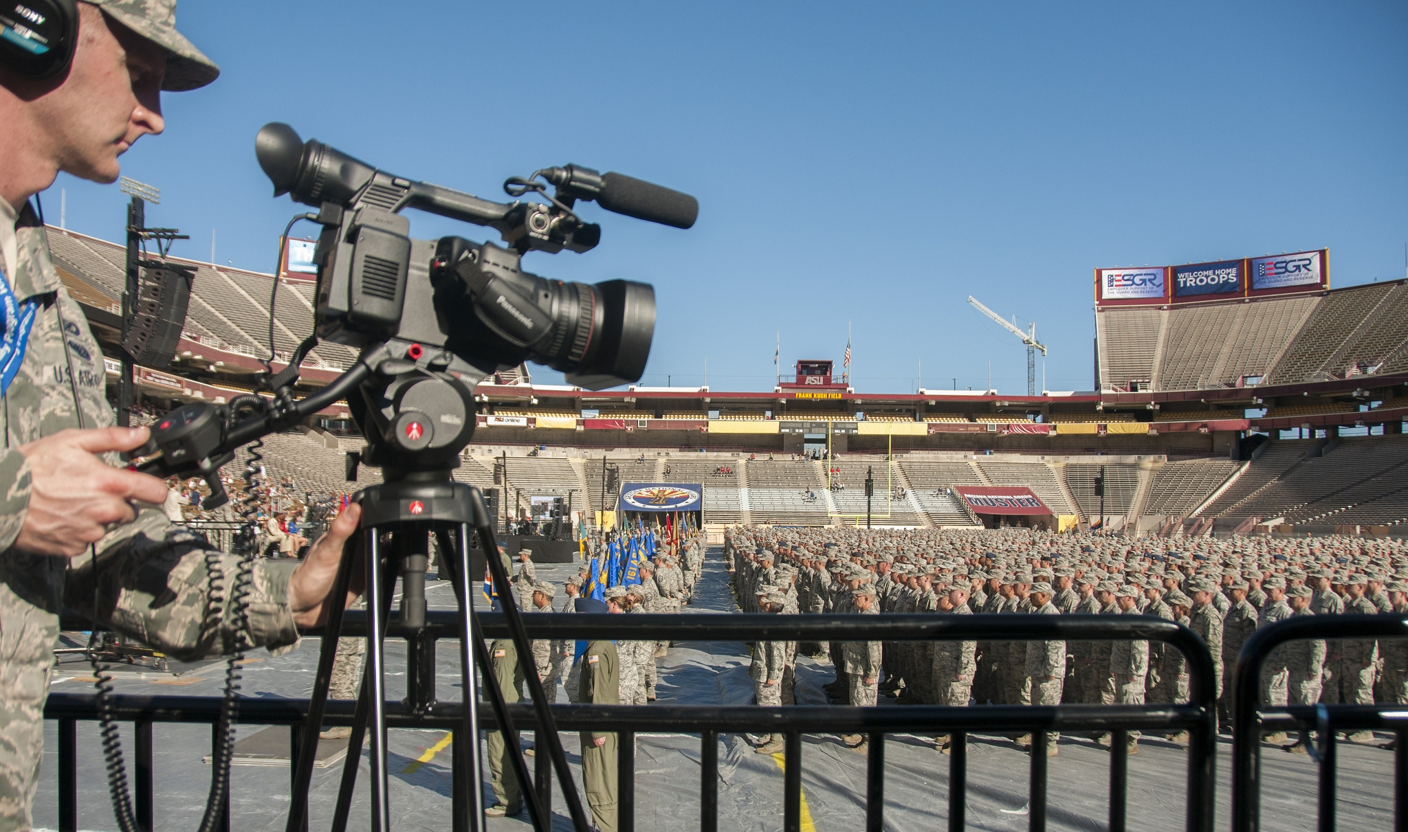 Public Affiairs videographer takes video at 2014 Muster