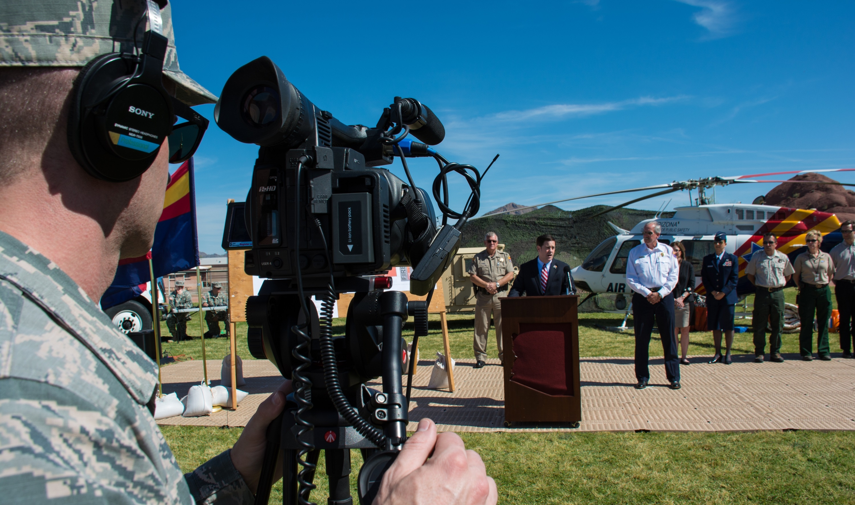 An Arizona Air National Guard braodcaster takes video at a press conference
