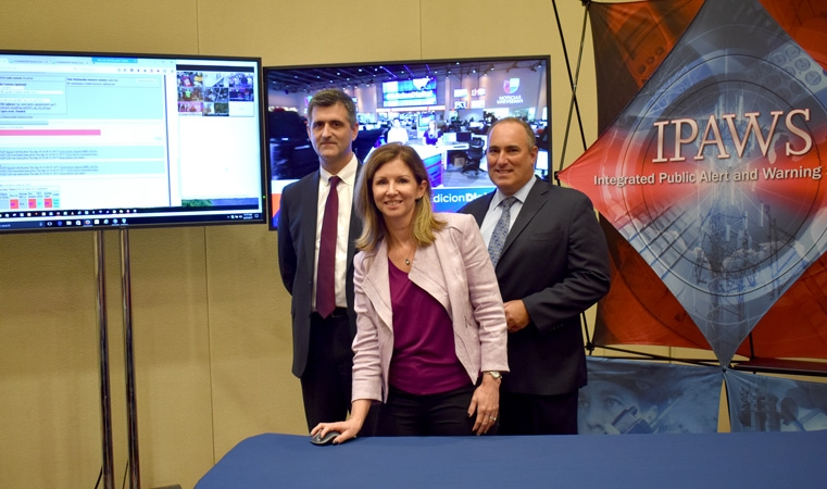 Partners from FEMA and the Deputy Director of the Arizona Department of Emergency and Military Affairs prepare to launch the IPAWS national Emergency Alery System test