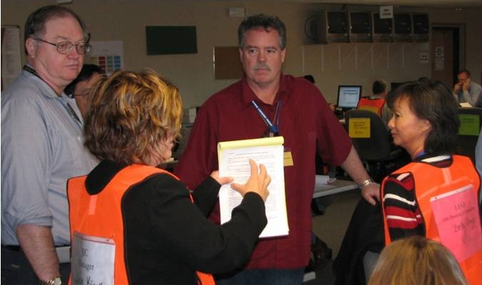 Public information officers discuss events during a state exercise.