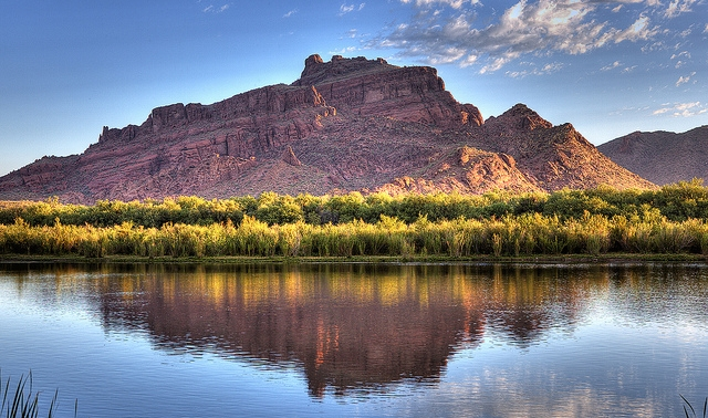 Photo of Red Mountain reflecting in water
