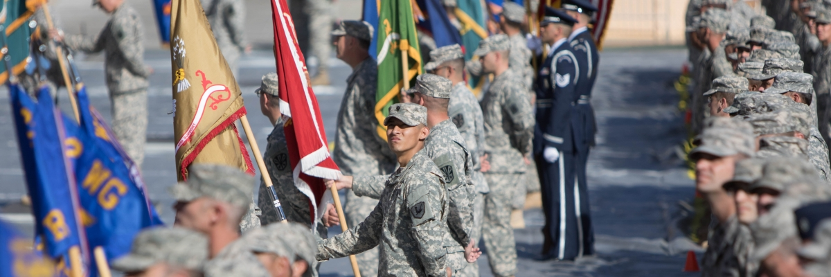 soldiers and airmen stand side by side in formation