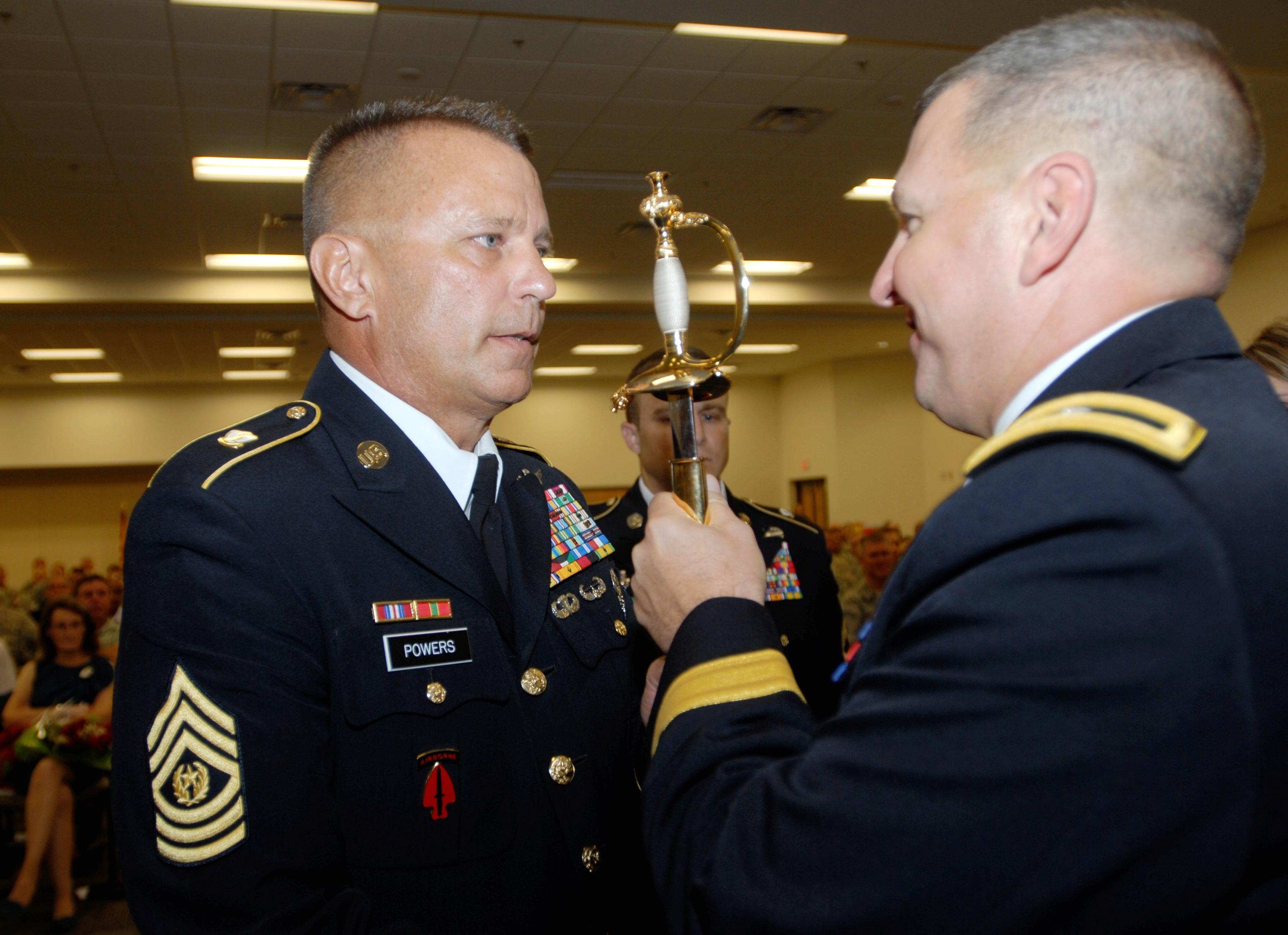 Command Sgt. Maj. Patrick Powers receives the Noncommissioned Officer's Sword