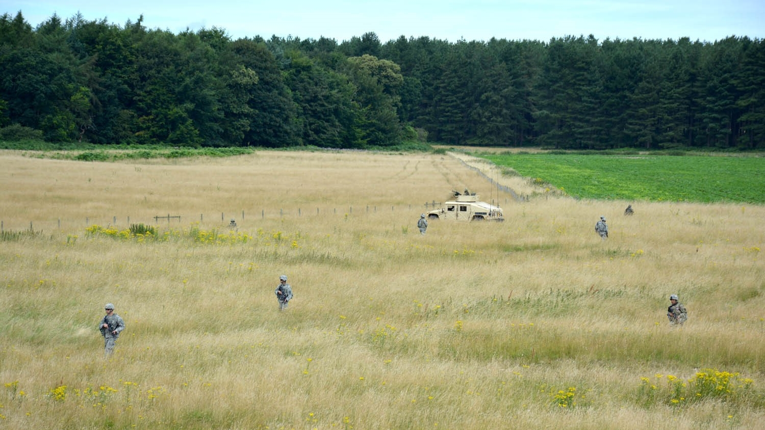 Soldiers patrol the outer-perimeter of a village, on the Stanford Training Area, United Kingdom, during the culminating event of Steppe Eagle 2016, on July 29