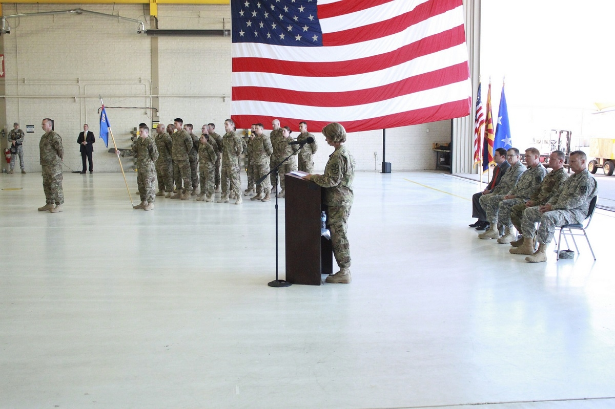 The commander of F Company, 1st Battalion, 168th ATS delivers her remarks during their deployment ceremony Oct. 2 at Papago Park Military Reservation. The company will provide tactical air traffic control and ground control approach radar services in support of Operation Inherent Resolve for their year long deployment.