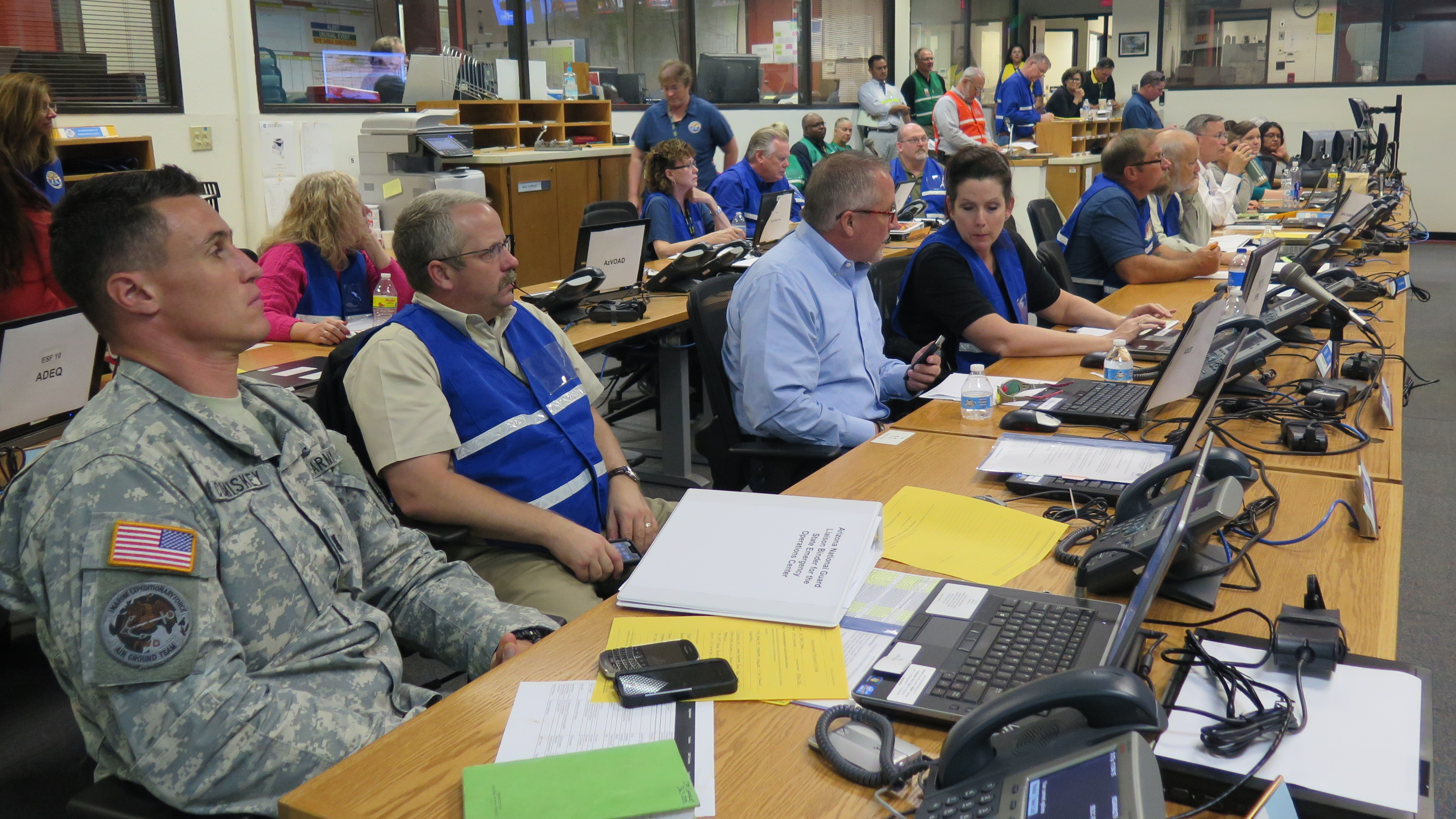 People working in the SEOC during the 2015 Statewide Earthquake exercise.
