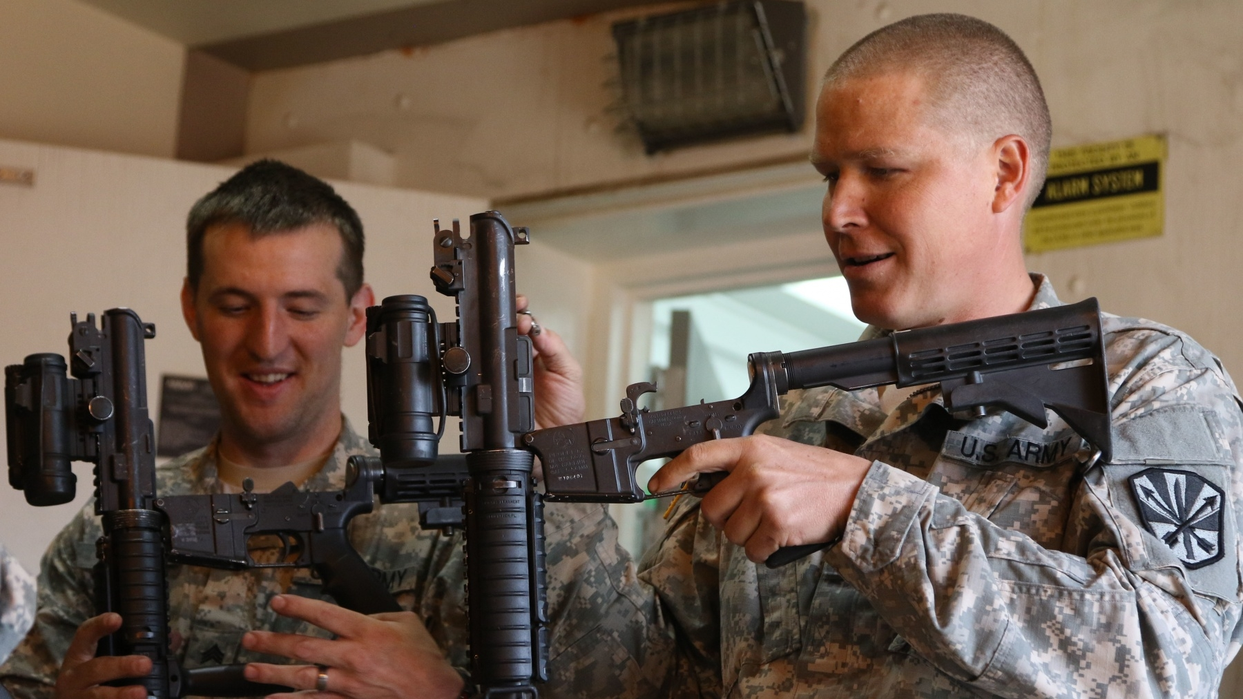 Alaska Army National Guard Sgt. Marshall Webb and Arizona Army National Guard Spc. Randall C. Goodin Jr., inspect M-4 carbines, June 22, at Fort Greely, Alaska.
