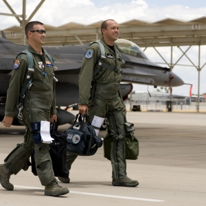 Pilots walking on an F-16 flightline