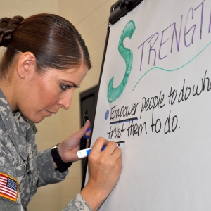 Army Spc. Ciara Laboy takes notes