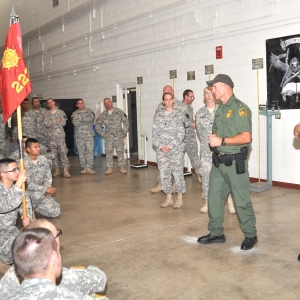 Border patrol agent speaking to Soldiers