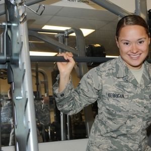 Airman posing in a gym