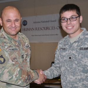 A hiring manager shakes hands with a newly hired employee