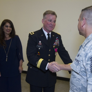 Brigadier General Kahler shakes hands with an airmen after his promotion