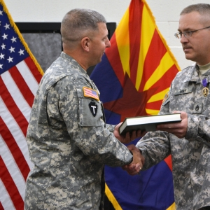 General giving the Purple Heart to a Soldier