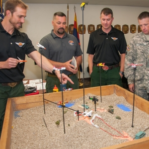 Members of the U.S. Forest Service and the Arizona National Guard's 2-285 Aviatio unit train for wildfire response